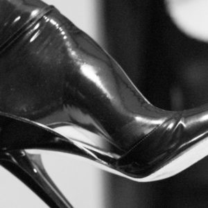 Latex stockinged feet in black high heels